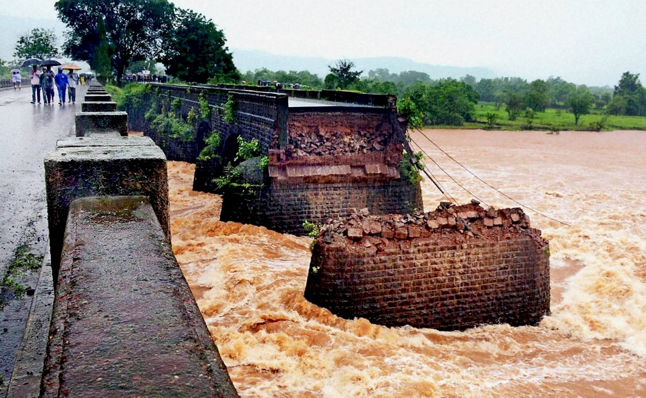 "Meanwhile, Maharashtra Chief Minister Devendra Fadnavis tweeted that the primary reason for the collapse seems to be ""the high pressure caused due to flooding of river Savitri due to heavy rains in the catchment of Mahabaleshwar."" PTI"