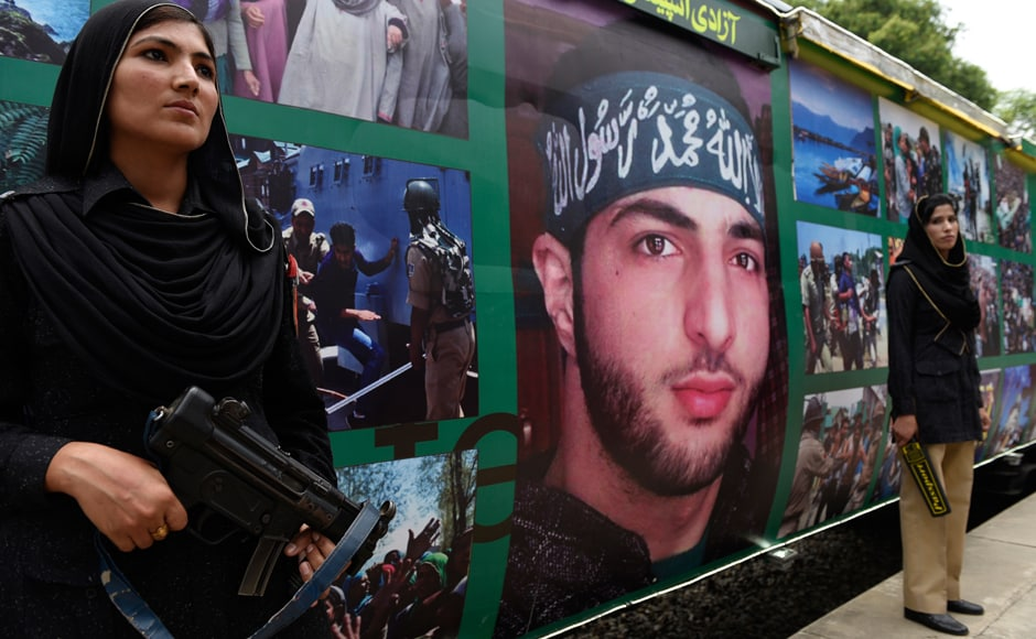 Female Pakistani police officers stand guard outside a train decorated with pictures of slain Indian Kashmiri rebel leader Burhan Wani, for the upcoming Independence Day in Islamabad, Pakistan, Thursday, Aug. 11, 2016. Pakistan railway has designed a special train called Independence Train to celebrate the 70th independence day on Aug. 14, 2016. AP
