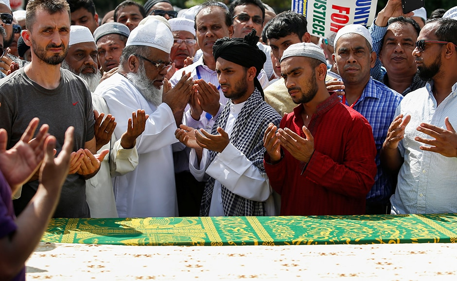 Community members pray next to the coffins of Imam Akonjee. Muslim representatives pointed to growing Islamophobia and anti-Muslim sentiment in the country in the light of attacks in the US and abroad as well as hostile statements by Republican presidential candidate Donald Trump. Reuters