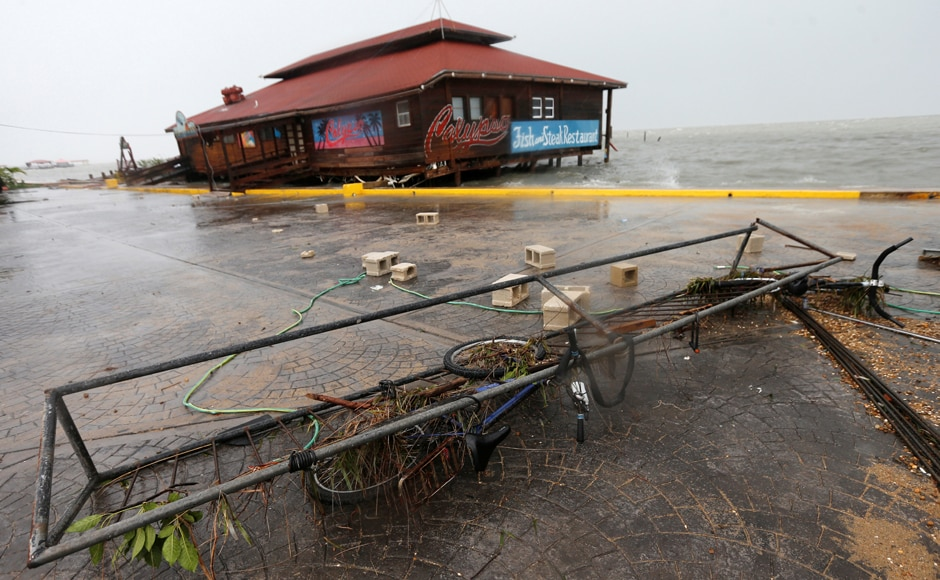 A bicycle and debris are seen along the beach, after Hurricane Earl hit Belize City. Belize's National Emergency Management Organization had warned of a threat of flash floods and mudslides and flooding in low-lying areas. Reuters