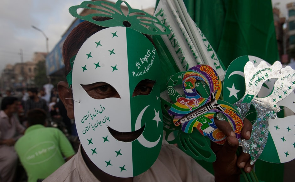 A Pakistani vendor sells Pakistani flags, mask and badges ahead of Pakistan Independence Day in Karachi, Pakistan, Thursday, Aug. 11, 2016. Pakistan will celebrate its 70th independence day on Aug. 14, 2016. AP