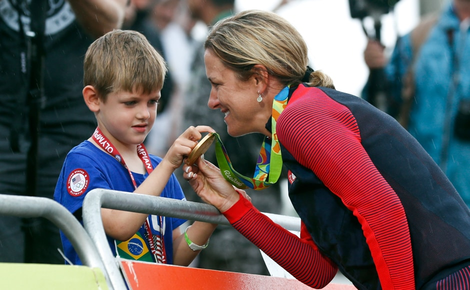 "Armstrong shows her gold medal to her son Lucas William Savola. When the 5-year-old approached her at the finish, he asked, ""Mama, why are you crying? You won!"" Once again. ""That's a great question from a 5-year-old,"" Armstrong said with her now-familiar grin. ""That's what we do, we cry when we're happy. I'm going to have to explain that one to him a little later."" AP"
