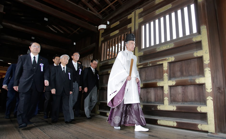 Japanese lawmakers visited the Yasukuni Shrine to offer prayers to the war dead. The Shrine honours millions of mostly Japanese war dead, as well as senior military and political figures convicted of war crimes after the war. Photo: AP