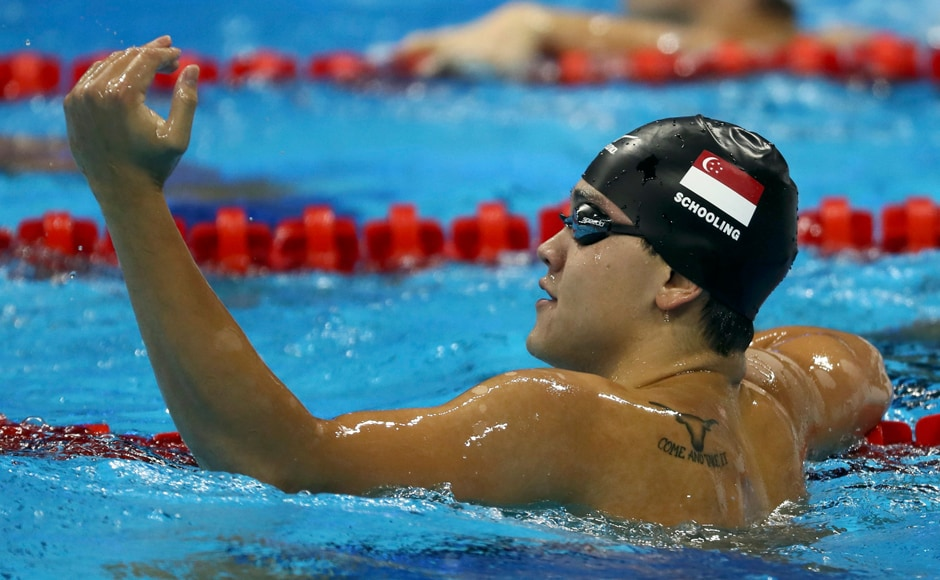 Joseph Schooling of Singapore celebrates after winning Men's 100m Butterfly Final. Reuters
