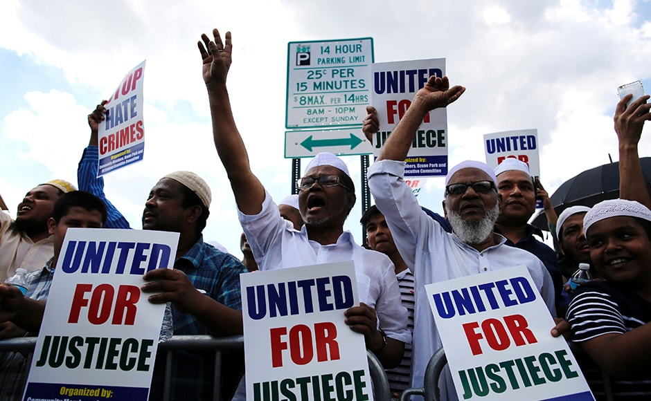 Muslim representatives shout slogans as they gather for the funeral service of the Imam. The police on Monday arrested Oscar Morel, a local from the neighbouring borough of Brooklyn, for the murder of the Imam and one of his associate. Reuters