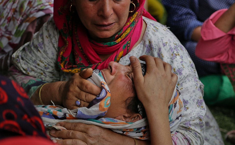 Two more civilians, on Tuesday, were killed in central Kashmir's Budgam district when CRPF personnel opened fire on a group of protesters in Aripanthan area of Beerwah. An unidentified family member of a killed civilian cries during a joint funeral of the slain four civilians. AP