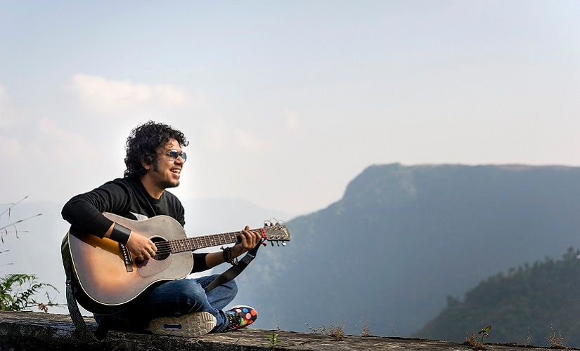 Papon poses for a portrait during the Red Bull Tour Bus Hometown Heroes 2015 India tour while driving to Guwahati on December 5, 2015
