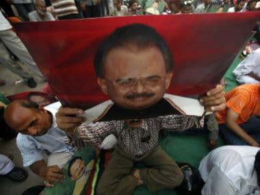 A supporter holds a poster of Altaf Hussain. Reuters