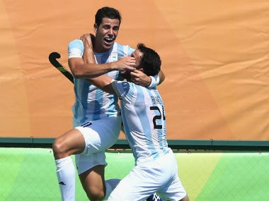 Joaquin Menini (L) celebrates with Manuel Brunet, after Argentina hammered their fifth goal against Germany. Getty Images