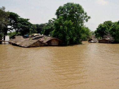 Houses submerge in floodwater in Bihar. PTI