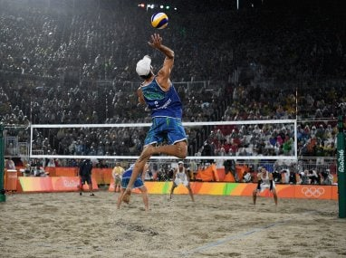 Bruno Schmidt Oscar of Brazil serves during the Men's Beach Volleyball Gold medal match. Getty