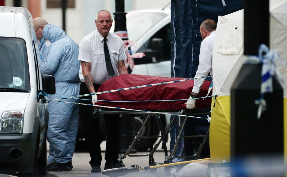 A body is removed from the scene in Russell Square, central London, after a knife attack on Thursday, 4 August, 2016. A woman has died and others were injured in a knife attack in a central part of London, the police said. AP