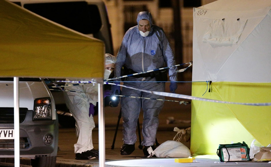 Police forensic officers work at work in Russell Square, after a knife attack. The police suggested that the attacker may be mentally unstable but haven't ruled out terror links as a potential motive behind the attacks. AP