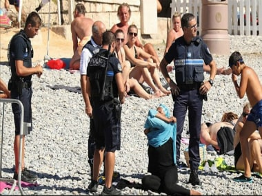 Image of the woman being asked to remove her burkini. Twitter