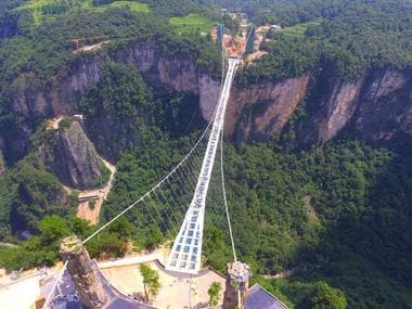 People visit a glass bridge at a gorge as it opens to public in Zhangjiajie, China. Reuters