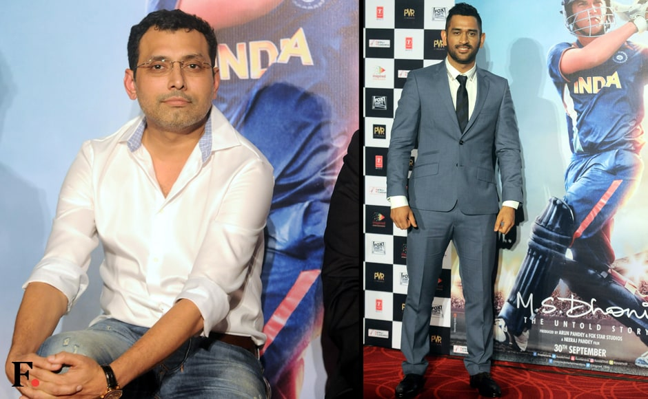 Director of MS Dhoni: The Untold Story, Neeraj Pandey and Dhoni posing with the film's poster. Sachin Gokhale/Firstpost