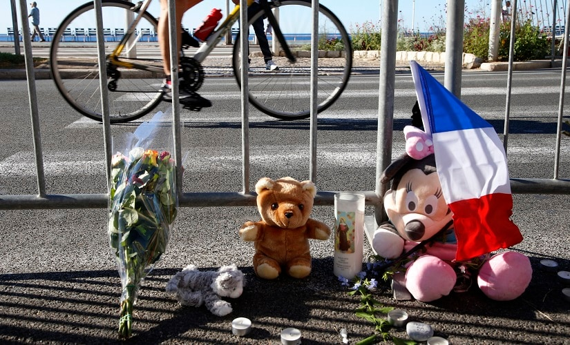 A bouquet of flowers, stuffed toys and a French flag placed in tribute to Nice attck victims. Reuters