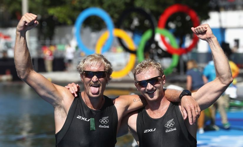 Eric Murray and Hamish Bond react after winning the gold medal. Getty