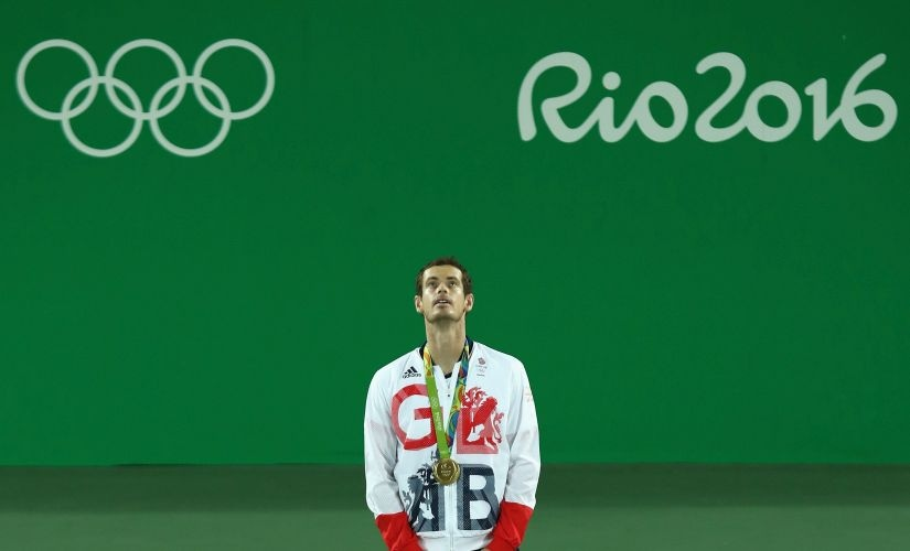 Andy Murray poses on the podium. Getty