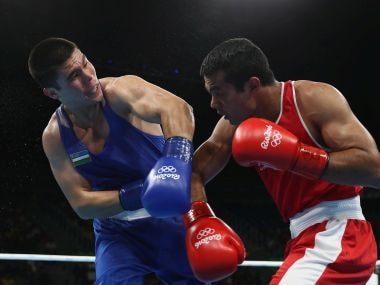 Bektemir Melikuziev fights Krishan Vikas in the mens middleweight 75kg. Getty