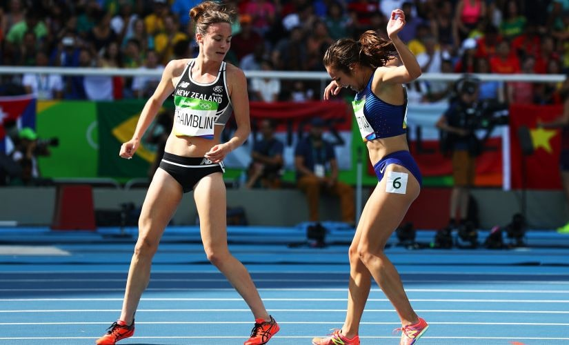 Abbey D'Agostino and Nikki Hamblin react after a collision. Getty
