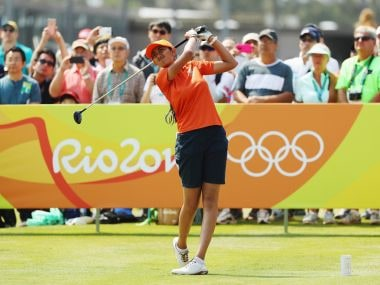 Aditi Ashok watches her tee shot on the first hole. Getty