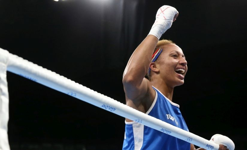 Estelle Mossely reacts after defeating Junhua Yin in the Women's Light Final Bout. Getty