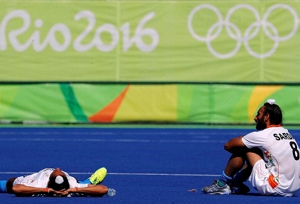 India's hockey players at the end of the defeat against Belgium. AP