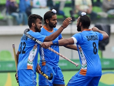 India's hockey players celebrate a goal against Canada. PTI