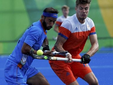 India's Ramandeep Singh vies for the ball with Netherlands players.  PTI