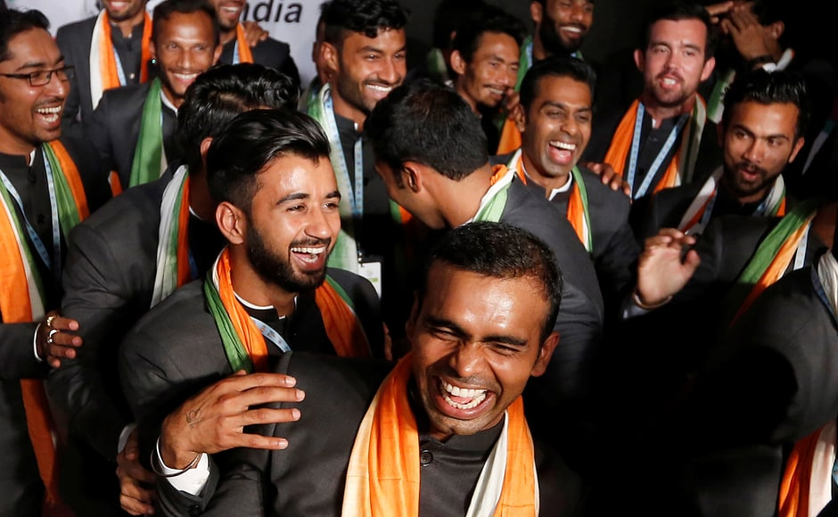 Members of the Indian hockey team, led by captain Sreejesh Raveendran (c), share a light moment ahead of the opening ceremony. Reuters