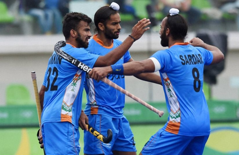 India's Sardar Singh celebrate with team mates after a goal against Canada. PTI