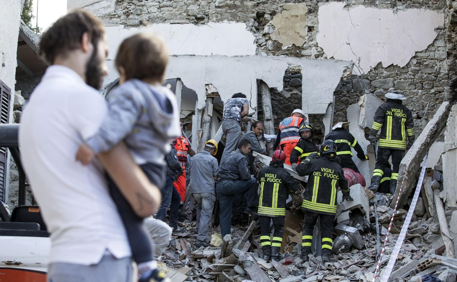 Firefighters search amid rubble for survivors as the death toll rises to 247  following the earthquake in Accumoli. AP