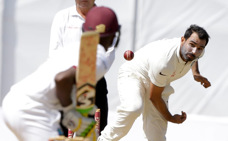 India's Mohammed Shami bowls a delivery, they started the Day 5 as firm favourites as they needed to pick up just six wickets to seal their second win against West Indies. AP