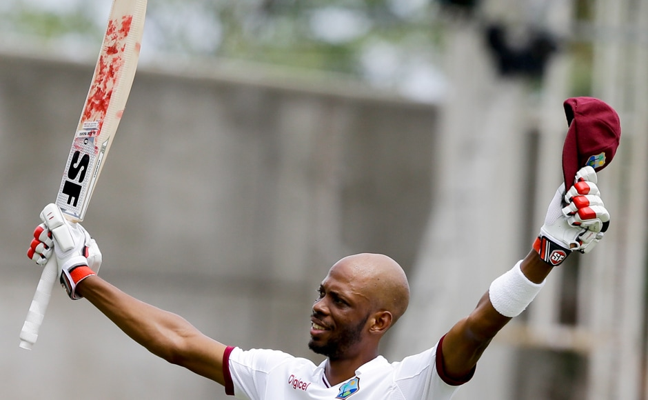 West Indies' Roston Chase celebrates his maiden ton, he also scalped a maiden five wicket haul in the same match which made him a overnight hero in Jamaica. AP
