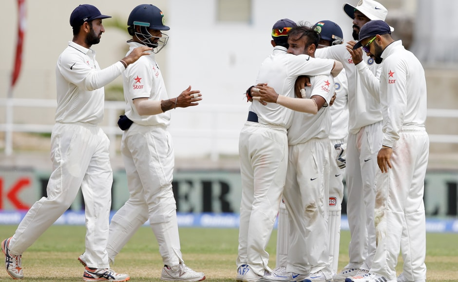 Indian cricket team celebrates a wicket taken by Amit Mishra of Shane Dowrich, who was disappointed after replay should a huge inside wicket onto his front pad for his LBW dismissal. AP