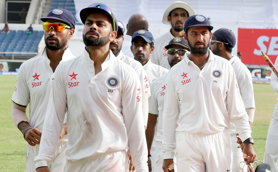 Indian team walks off after Virat Kohli and West Indian captain Jason Holder shook hands on Day 5 after no outcome was possible for either side. AP