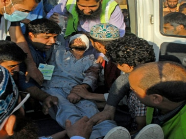 Srinagar: An injured youth being shifted to SMHS hospital after a clash between the security forces and protesters at Budgam in Srinagar on Friday. PTI