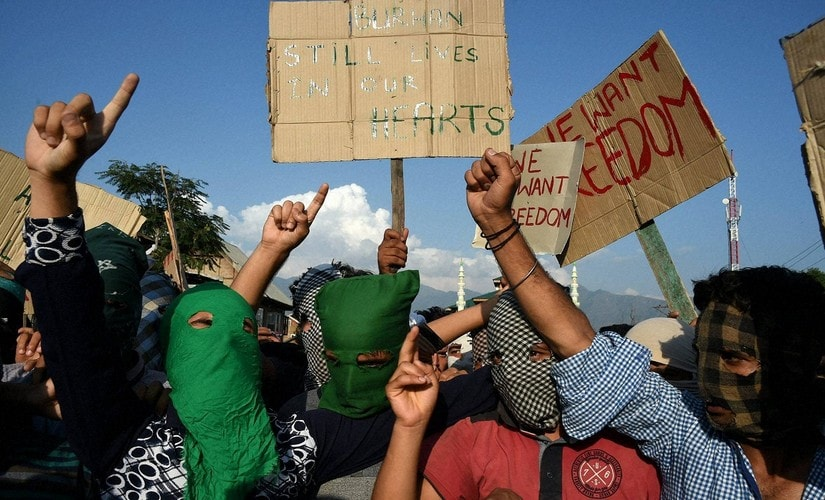 Srinagar: Protesters holding placards and shout slogans during a protest in Srinagar on Sunday. PTI Photo by S Irfan(PTI7_31_2016_000185B)