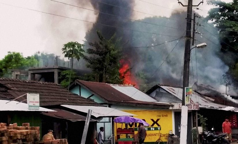 Smoke billowing out of shops after an attack by NDFB (S) terrorists in the market area at Balajan Tinali near Kokrajhar town in Assam on Friday. PTI