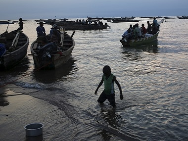 Fishermen sit in boats as they go for night fishing in Lake Tanganyika. Reuters