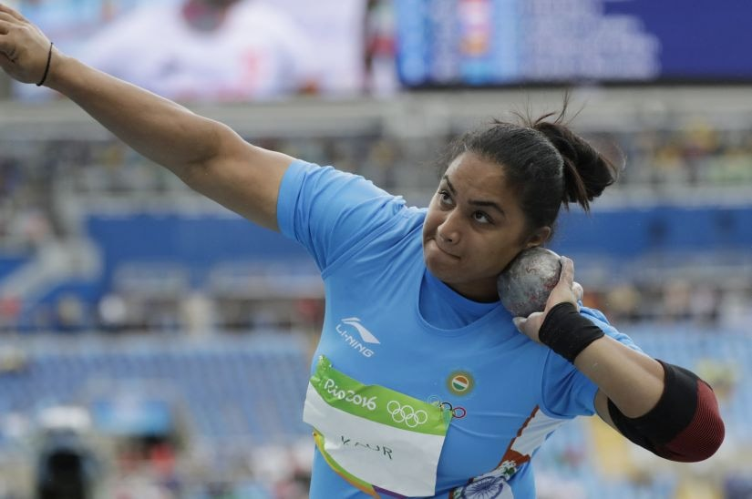 Manpreet Kaur competes in a qualifying round of the women's shot put. AP