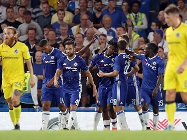 Chelsea players celebrate scoring a goal against Bristol Rovers. AP