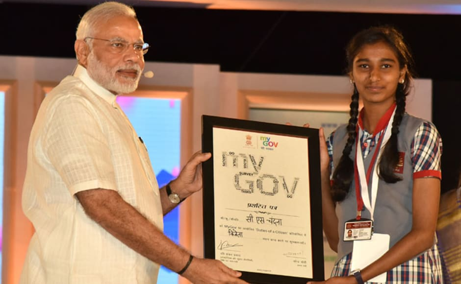 Before taking up the citizens' questions, Modi felicitated the winners of the MyGov contest. Photo: PIB
