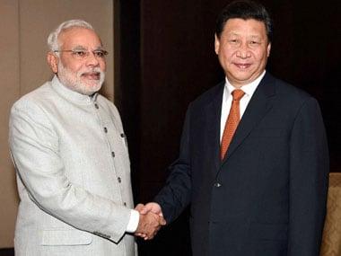 China President Xi Jinping with Prime Minister Narendra Modi. PTI