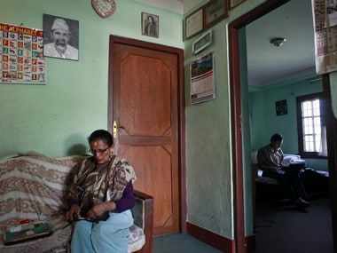 In this photo taken on Tuesday, Aug. 9, 2016, Indira Adhikari, left, and Suman Adhikari are seen at their home in Kathmandu, Nepal. The mother and son have very little hope of getting justice for Muktinath Adhikari, who was dragged out of a classroom he was teaching, tied to a tree and riddled with bullets by alleged maoists for refusing to part with a portion of his salary to fuel their rebellion. Now the very same rebels are politicians controlling the nation's government and want everyone to forgive and forget what happened during the conflict. (AP Photo/Niranjan Shrestha)