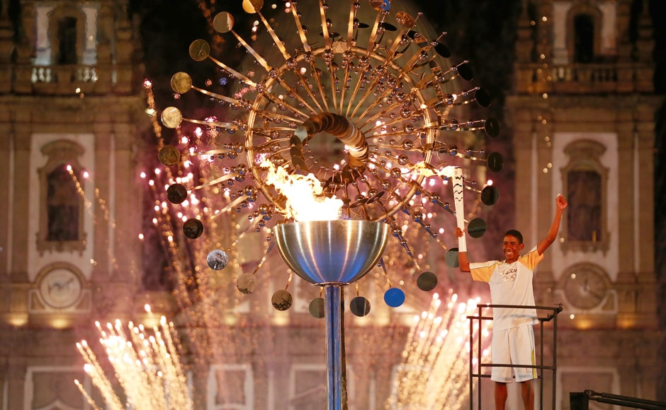 The Olympic cauldron is lit by Jorge Alderto de Oliveira Gomes in front of the Candelaria church in central Rio de Janeiro. Reuters