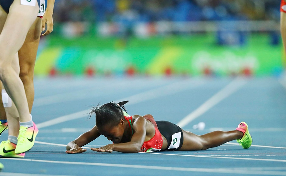Faith Chepngetich Kipyegon of Kenya lies on the track after winning gold in the women's 1500m final. Reuters