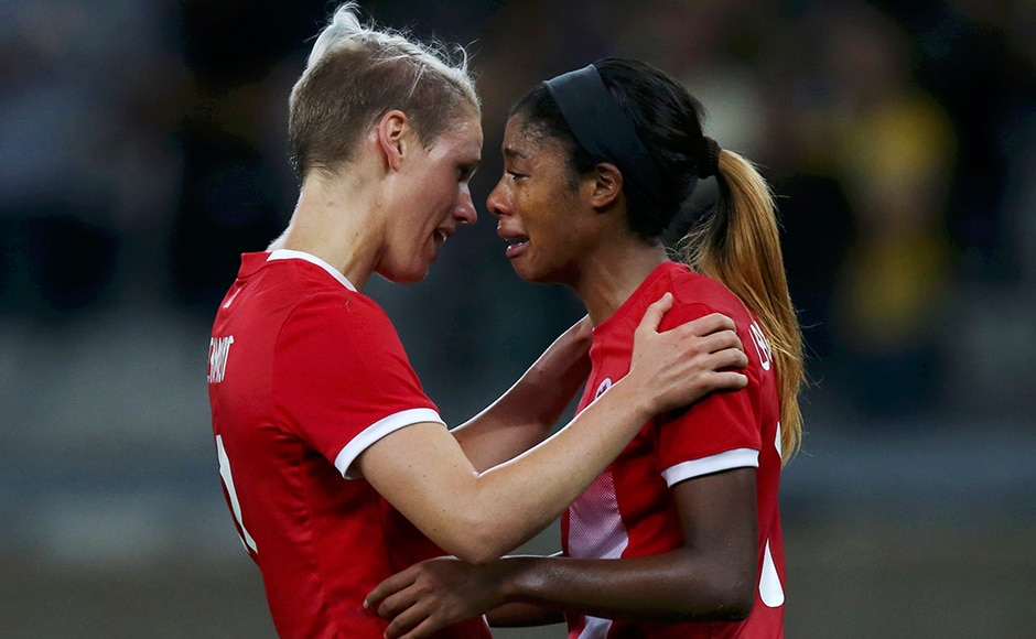 Sophie Schmidt and Ashley Lawrence of Canada react after their loss against Germany in the women's football semifinal match. Reuters