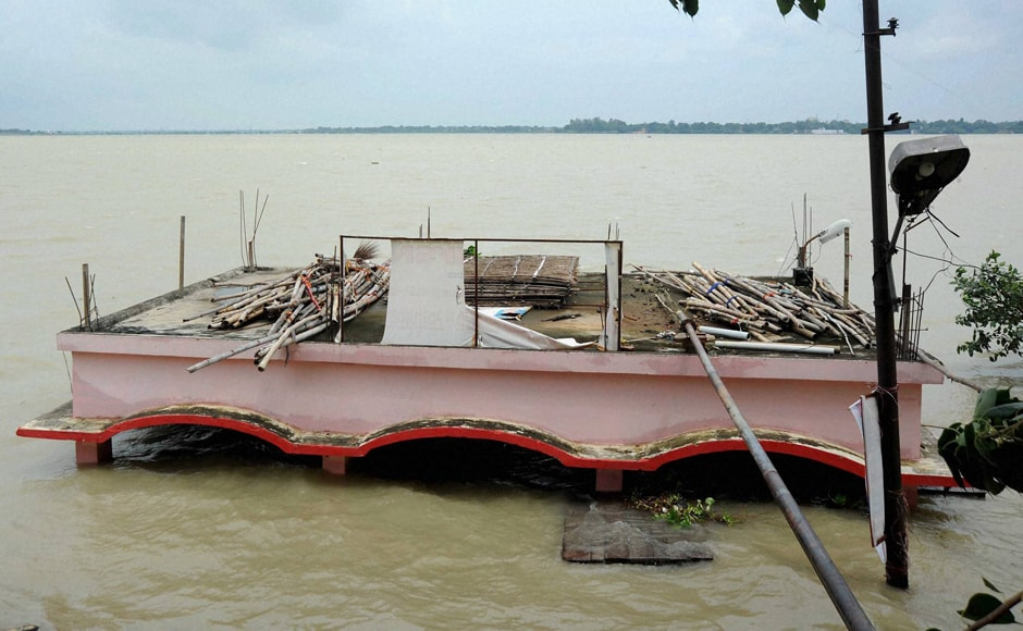After heavy rainfall in Uttar Pradesh and other catchment areas of the Ganga river, Allahabad is experiencing floods in low-lying areas. A shelter at the bank of Ganga River is seen submerged in water as the regional Met department has predicted continued rains in eastern Uttar Pradesh. PTI
